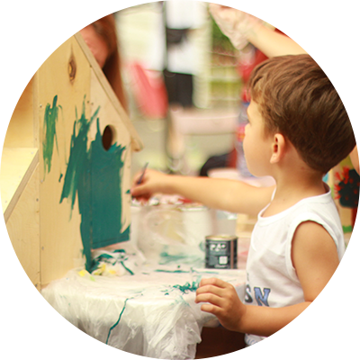 boy painting wooden project